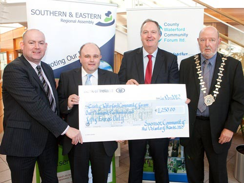 Presentation of sponsorship cheque to County Waterford Community Forum Ltd. S&E Regional Assembly - Social Enterprise Award Sponsor. L-R Tom Gillian, Waterford Co.Co. Vincent Dunphy, S&E Assembly, Mic
