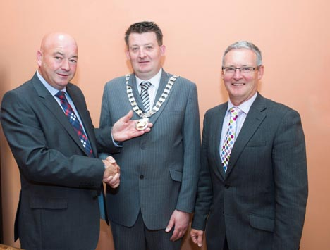 Cllr. Kevin O'Keeffe handing over the Chain of Office to newly elected Cathaoirleach, Cllr. Damien Geoghegan after the AGM in Assembly House on Friday 10th July