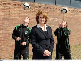 Minister for Social Protection, Joan Burton T.D. pictured during a visit to the Project FUTSAL Ballymun training hub with project FUTSAL participants Kevin Kelly and Christina Byrne. Picture credit: P