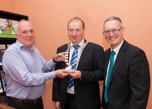 Cllr. Dermot Lacey handing over the Chain of Office to newly elected Cathaoirleach, Cllr. Thomas Kinsella (Left to Right: Cllr. Dermot Lacey with Stephen Blair, Director and Cllr. Thomas Kinsella, C